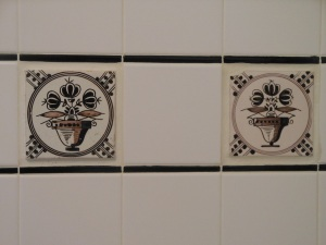 18th century tiles I bought in Delft the year we moved in to the house. I love the differences you can see even though they were both made from the same design template.