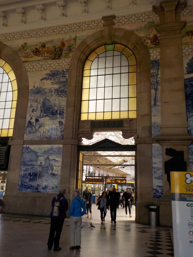 The blue and white tile was installed in the 19th c. when the station was built. The multicolored tile was added during the 20th century.