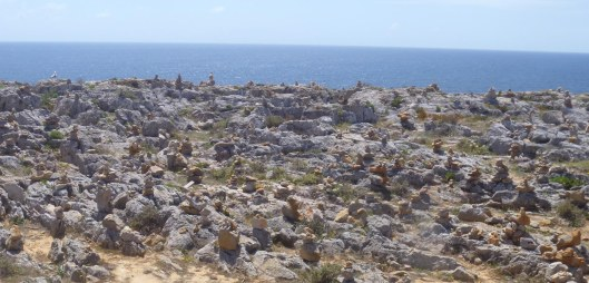 Visitors have built many small cairns of rock.
