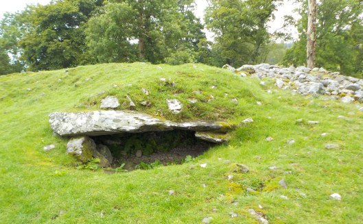 Opening into the cairn at left