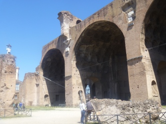 This is a portion of the Basilica of Maxentius. There is a third arch I couldn't fit in the photo. It takes up a small corner of the Forum. In the photo to the right, I dared Jonathan to stand under the high point of masonry that looks like it is ready to fall down.