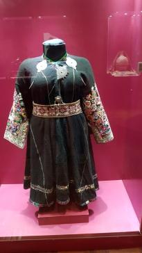 Three tupus/pins on a traditional dress